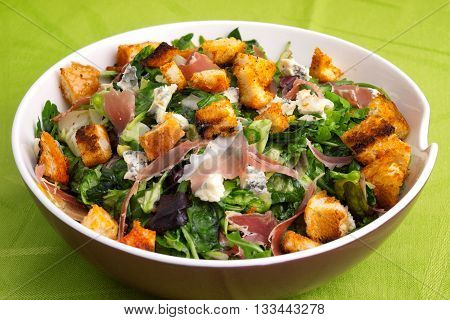 French Provencal Salad with green salad bacon croutons and blue cheese. Full length view.