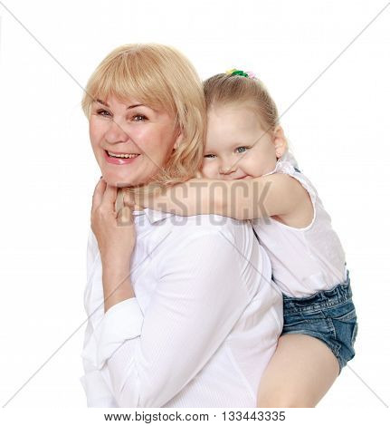 Happy little girl sitting on the back of his beloved grandmother - Isolated on white background