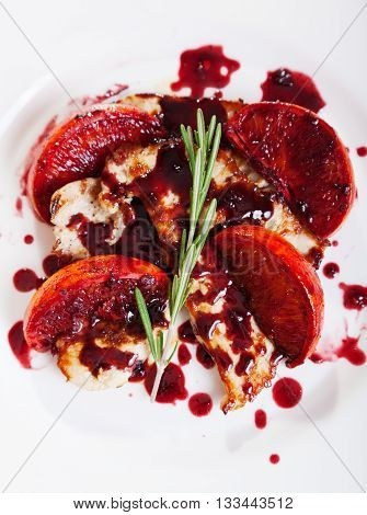 Turkey in orange sauce with cranberries. Shot from above.