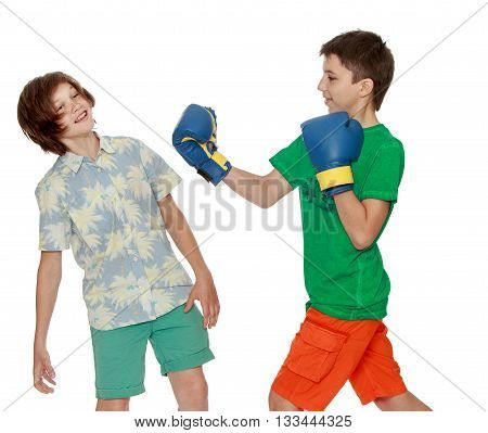 Two teenagers imitating a Boxing match-Isolated on white background