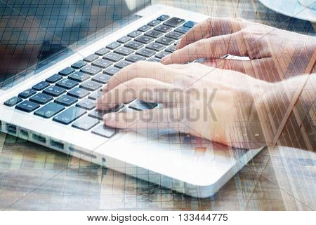 Someones hands typing on laptop keyboard. Double exposure.