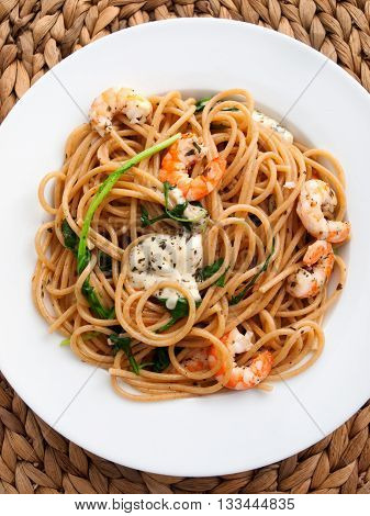 Italian spaghetti pasta with shrimps and cream. Shot from above vertical shot full length