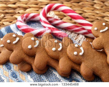 Row of homemade gingerbread men cookies. Horizontal shot