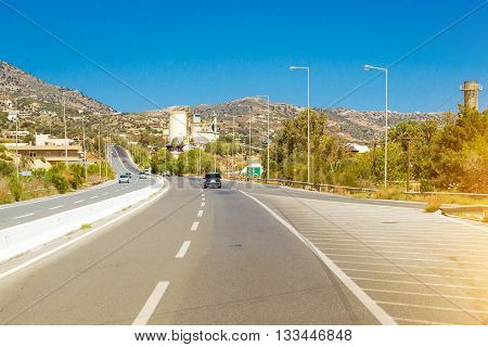 Mountain roads and serpentines of Crete cars move along the winding highway along the sea shore Heraklion Crete Greece