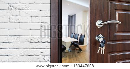 Welcome to the office. Half opened door to office. Door handle, door lock. Opening door. Entrance to the office workplace. Door at white brick wall, modern interior design.
