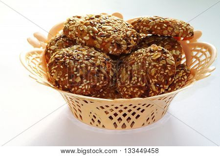 cookies in a basket on a white background