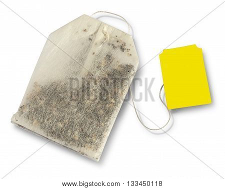 Teabag with yellow label. Top view. Isolated on a white. with clipping path
