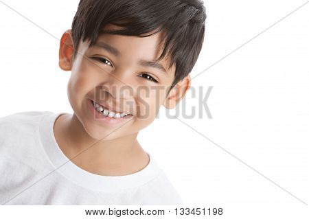 Close up portrait of a young, mixed race boy wearing a white t-shirt.  Isolated on white.