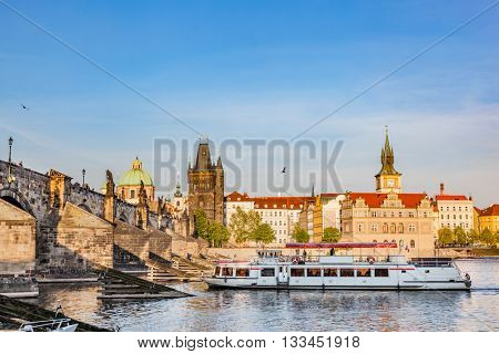 Prague, Czech Republic skyline with historic Charles Bridge. Boat cruise on Vltava river
