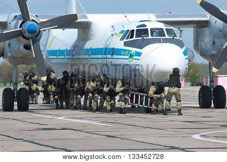 Kiev Region Ukraine - April 24 2012: Special operations sercice squad during the counter-terrosist training with a plane
