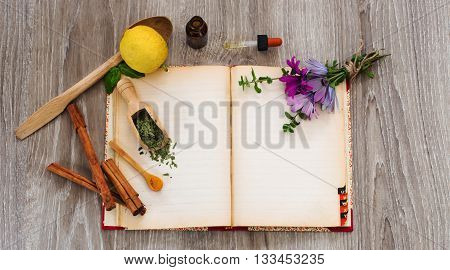 natural remedies for seasonal allergies and recipe book over wooden surface