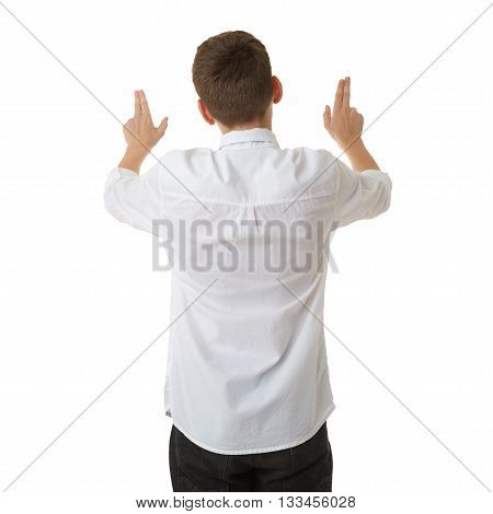 Cute teenager boy in white shirt and black bow tie working with virtual screen from back over white isolated background, half body