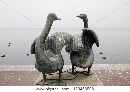Zug Switzerland - March 05 2011: Swan statue with bicycle lock at the lakeside.