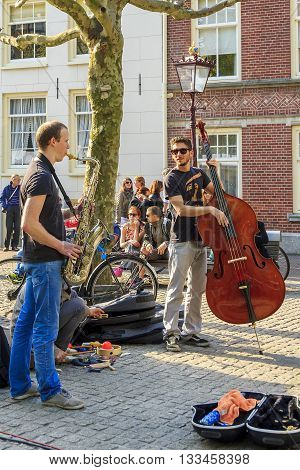 AMSTERDAM, NETHERLANDS - MAY 5, 2013: These are street musicians making a statement at the weekend on the streets of the city.