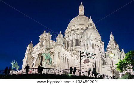 The basilica Sacre Coeur in evening Paris France.