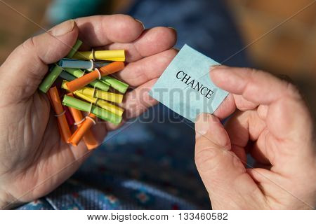 Older Hands Holding Lottery Tickets, Ticket With Word Chance