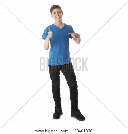 Cute teenager boy in blue T-shirt standing and pointing himself over white isolated background full body