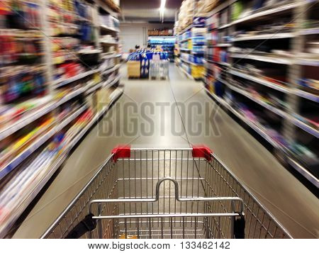 Shopping in supermarket. Shoping cart