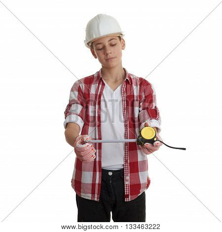 Cute teenager boy in red checkered shirt, building helmet and measuring tape over white isolated background, half body, constructing concept