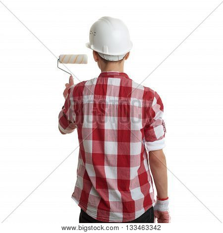 Cute teenager boy in red checkered shirt, building helmet and paint roller over white isolated background, half body, constructing concept