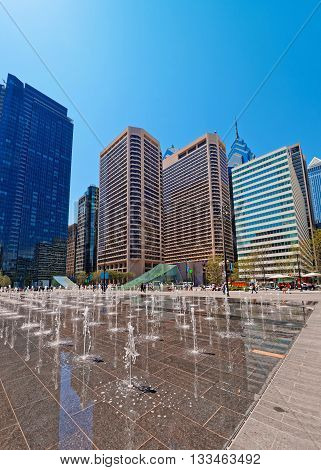 Penn Square With Street Fountains And Skyline Of Skyscrapers