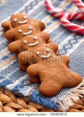 Row of home made gingerbread men cookies.