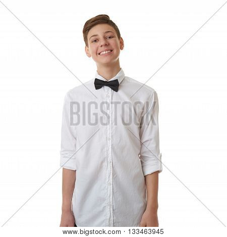 Cute teenager boy in white shirt and black bow tie over white isolated background, half body