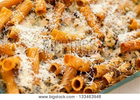 Baked Penne pasta with parmesan cheese. Shot from above. Horizontal macro shot