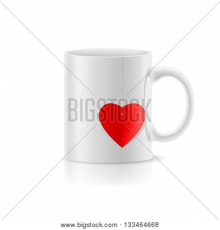 White cup with teabag in the form of heart
