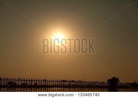 U Bein Bridge at sunset at Ayeyarwady River Mandalay Myanmar. Wide shot with copy space.
