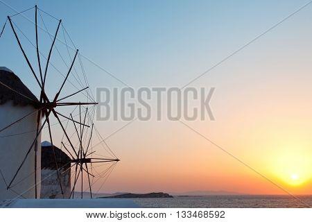 Two windmills at sunset in Mykonos island Greece