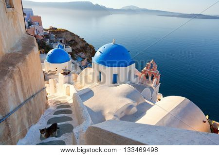 Churches and stairs in Oia Santorini. Shot at sunset. Horizontal view.