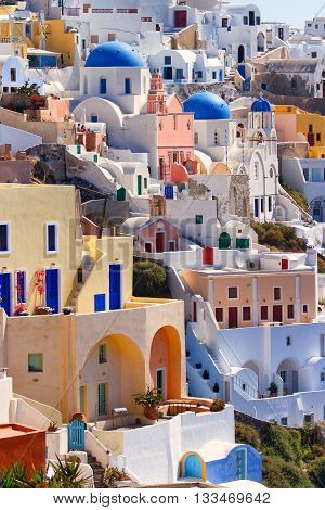 Vertical cityscape shot of the famous town Oia in Santorini Greece
