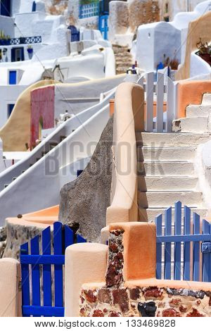 Close up of the narrow streets small doors and steep stairs of Oia town Santorini Greece. Vertical shot