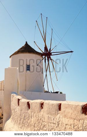 Windmill in Oia Santorini. Shot at sunrise. Vertical shot