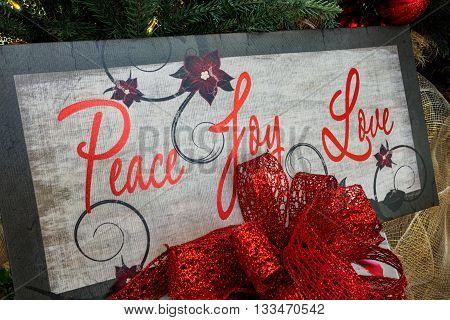 Closeup view of a Christmas board message on a tree that says