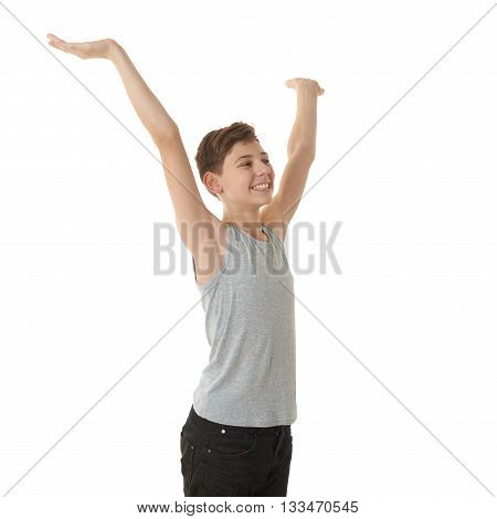 Cute teenager boy in gray shirt stretching hands up over white isolated background, half body