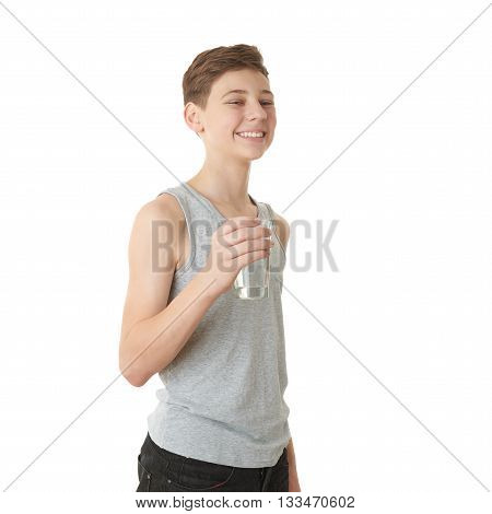 Cute teenager boy in gray shirt with glass of water over white isolated background, half body