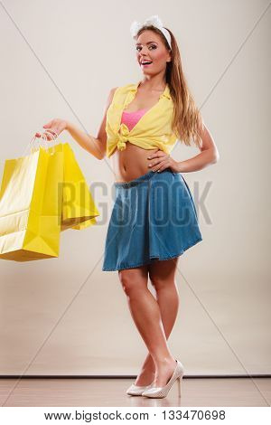 Happy Pin Up Girl Woman With Bags Shopping.