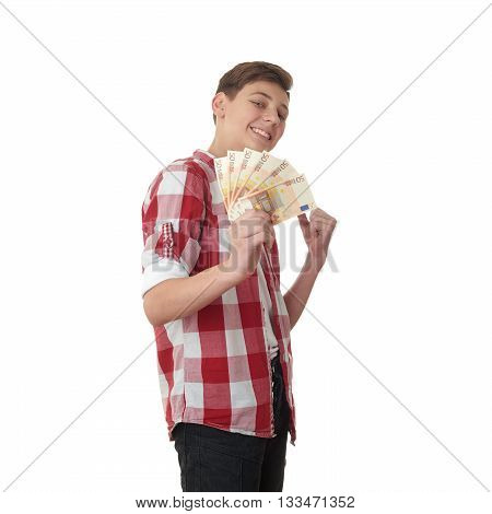 Cute teenager boy in red checkered shirt with money euro in hand over white isolated background, half body
