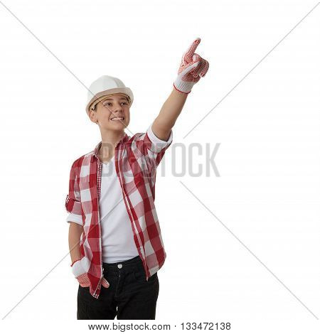Cute teenager boy in red checkered shirt and building helmet pointing up side over white isolated background, half body, constructing concept