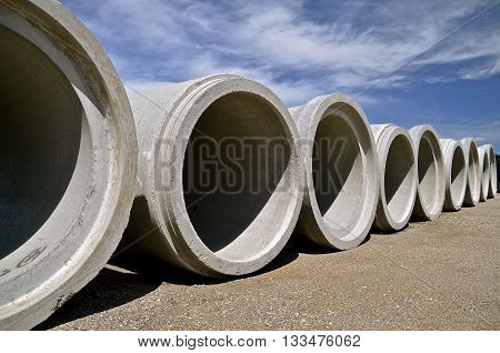 A row of huge concrete culverts  for engineering industrial projects where underground water diversion is necessary