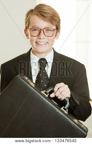 Smiling Boy In Business Suit Holding Brief Case