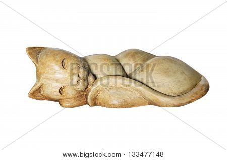 Cute sleeping wooden cat figurine isolated on a white background