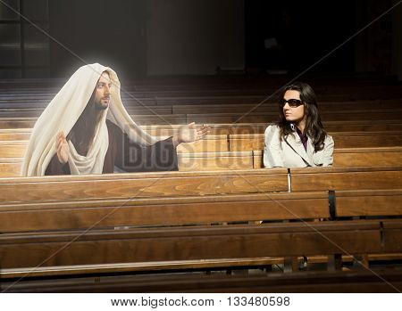 Woman praying in church and sees Jesus Christ.