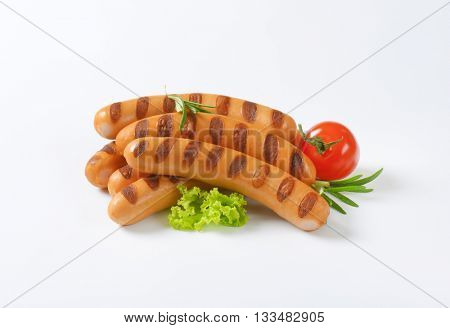 grilled wiener sausages on white background