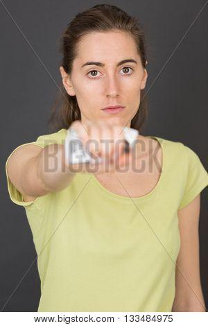 hand crushing cigarettes