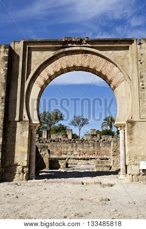 MEDINA AZAHARA, SPAIN - September  11, 2015: Detail of the main arch entrance of the Great Portico at Medina Azahara medieval palace-city near Cordoba on September  11, 2015 in Medina Azahara, Spain
