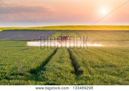Sunset Above Spraying Machine