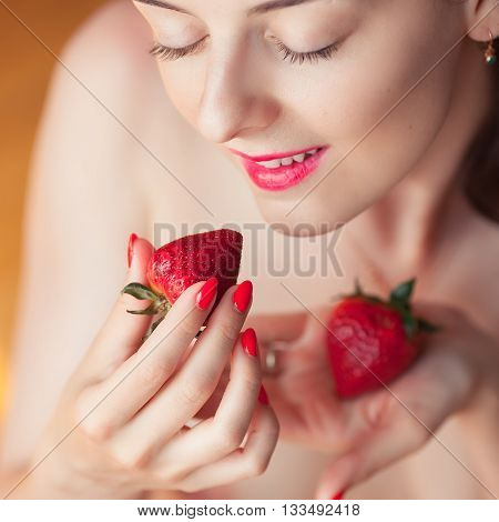 Photo Of Seductive Female Holding Strawberry Near Face Eyeys, Closeup Portrait Redhead Sensual Woman